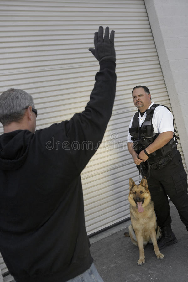 Security Guard Looking At Caught Thief stock image
