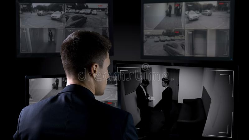 Security guard looking in corporative surveillance cameras, crime scene witness. Stock photo royalty free stock images