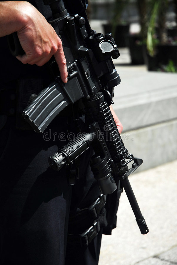 Security guard with machine gun stock image