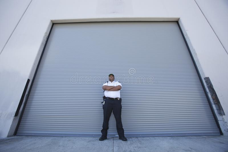 Download Security Guard Protects Warehouse Entrance Royalty Free Stock Photos - Image: 29666408