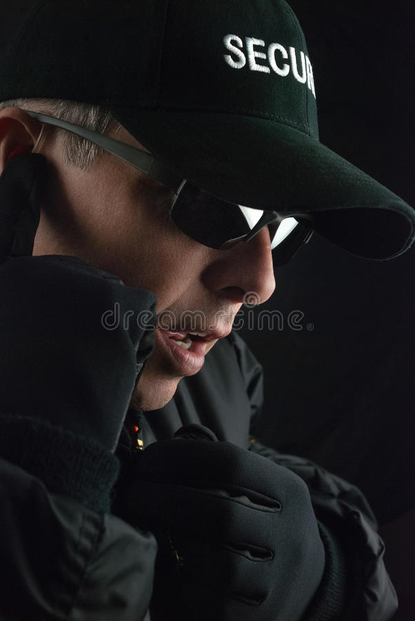 Security Guard Reports Into Microphone stock images