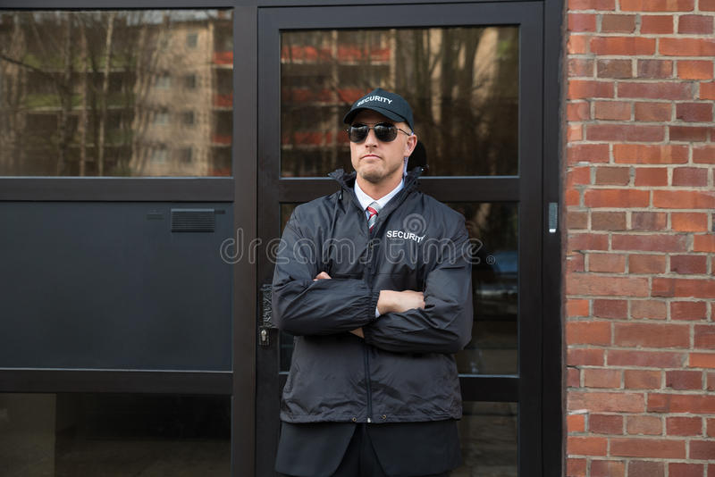 Security Guard Standing In Front Of The Entrance stock photo