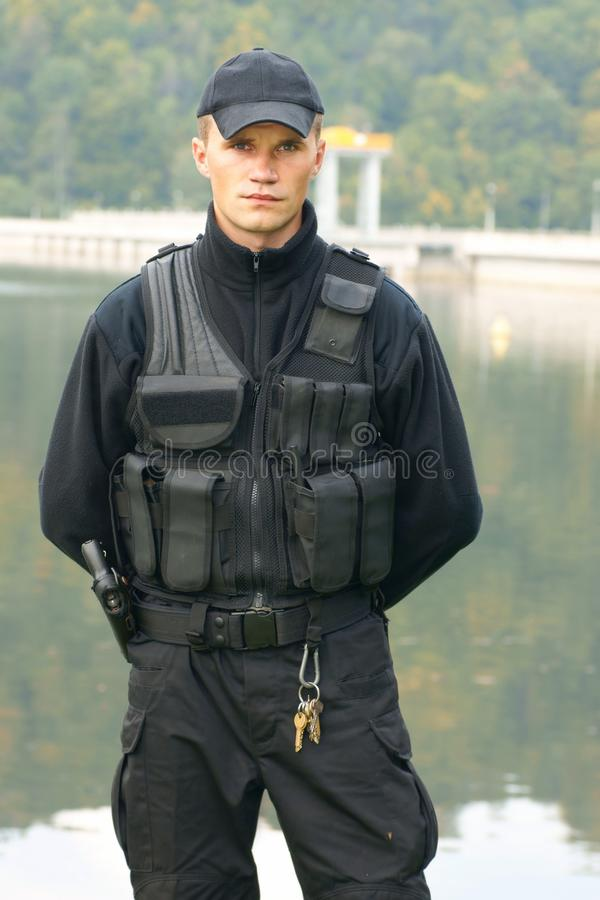 Security guard in uniform and armed. Security guard, in uniform and armed royalty free stock images