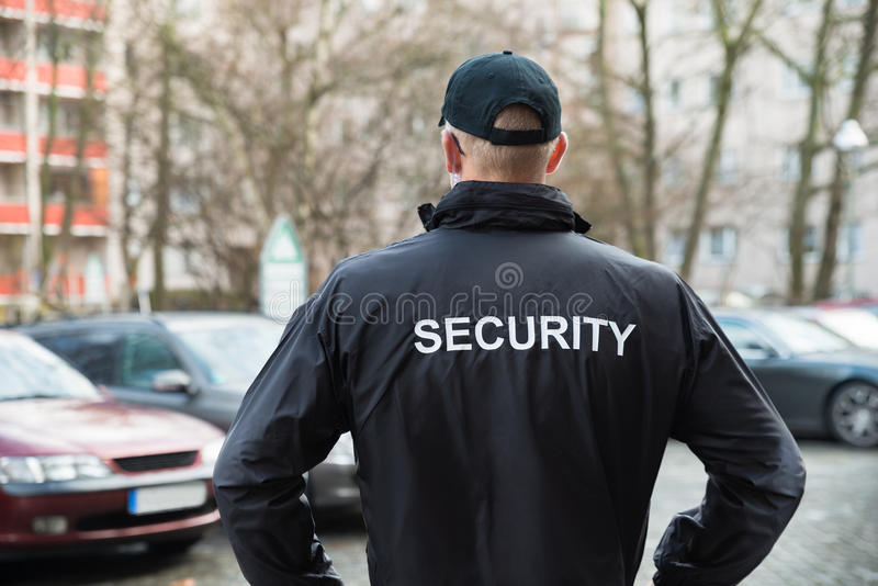 Security Guard Wearing Jacket stock photography