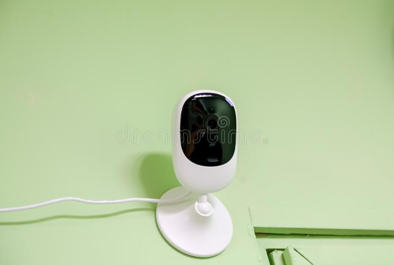 Security indoor camera on the wall in office royalty free stock images