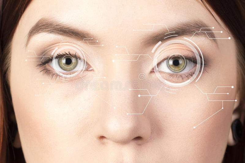 Security Iris or Retina Scanner being used on an Intense macro human Eye, with Limited Palette. stock photography