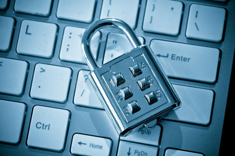Security lock on computer keyboard. Computer security and countermeasure on data encryption concept stock images