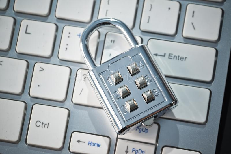 Security lock on computer keyboard. Computer security and countermeasure on data encryption concept royalty free stock image