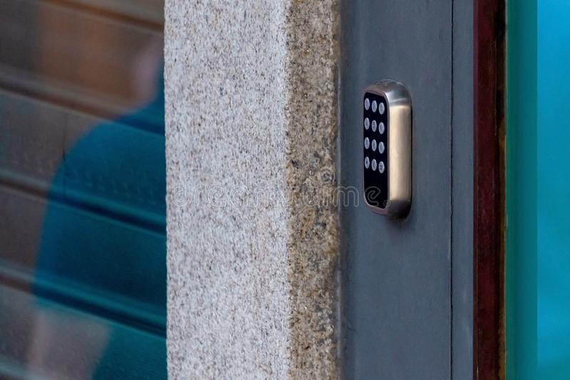 A security lock on an gate with a touch panel for access by an access code key stock images