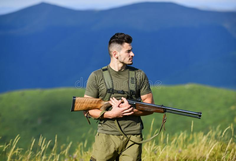 Security. military style. male in camouflage. army forces. sniper reach target mountain. man ready to fire. hunter hobby stock image