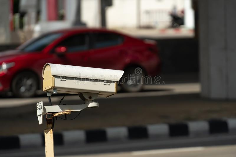 Security monitoring CCTV camera mounted on old pole stock photo