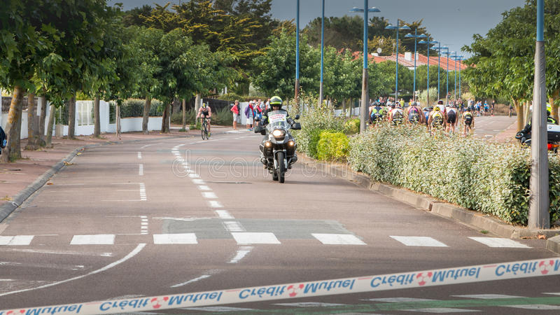 Security motorcycle for a road bike race royalty free stock photo