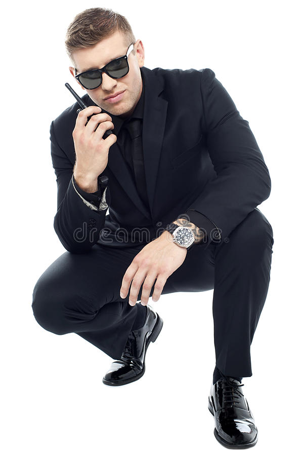 Security officer communicating and investigating stock images