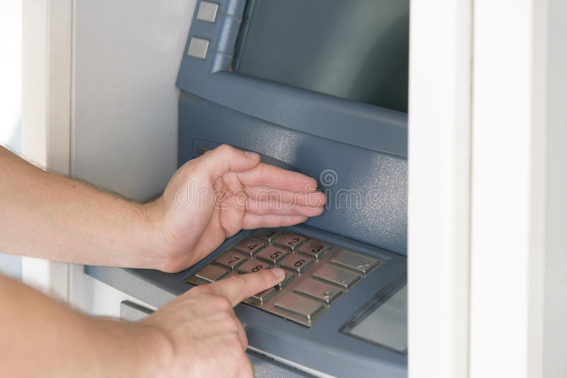 Security pin atm. Entering the pin code at the atm cash point royalty free stock photo