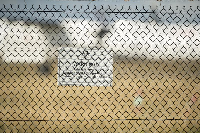 Security sign hanging on the fence at Brisbane Airport stock image