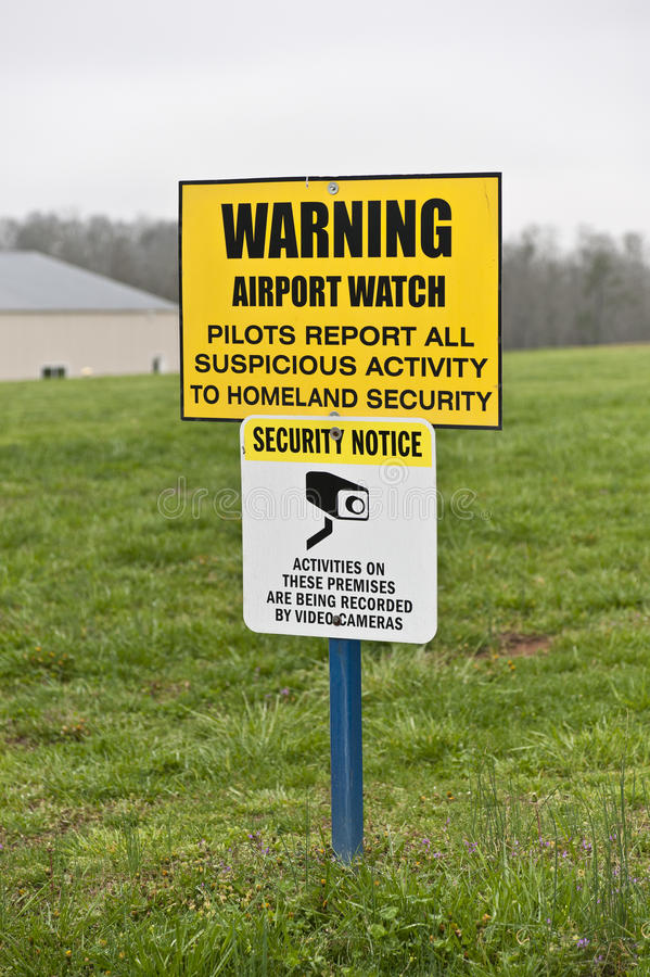 Security Sign At Small Municipal Airport. Yellow warning sign at a small municipal airport stock image