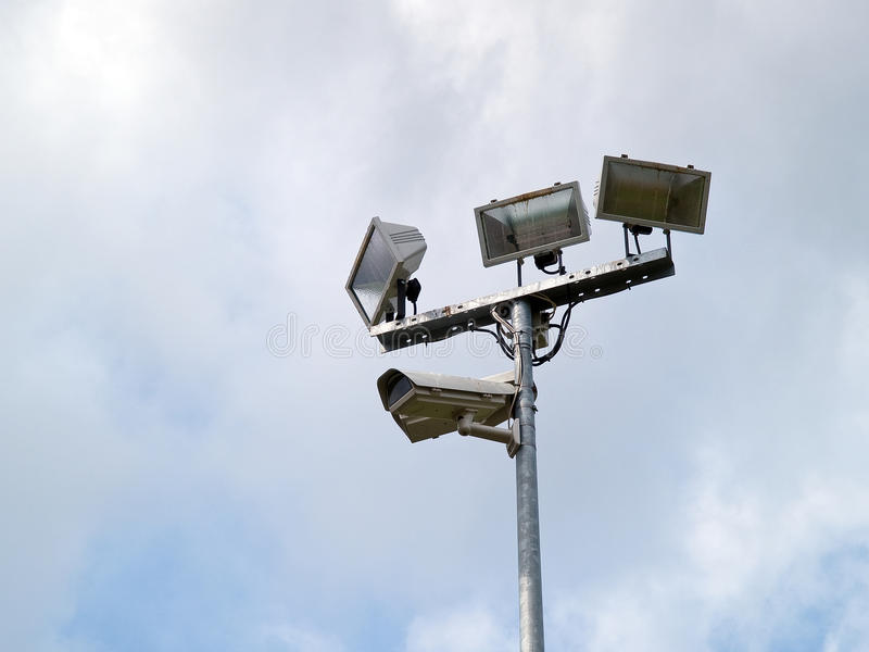 Security surveillance camera on a metal pole royalty free stock photo