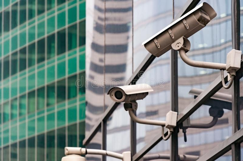 Security surveillance system at the entrance to a modern office building. Two cameras of video surveillance. royalty free stock image