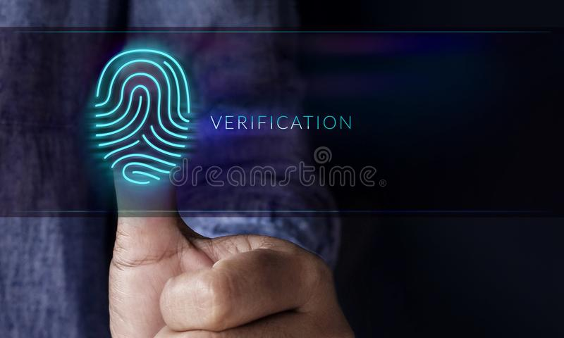 Security System by Verification Concept, Man pressing Fingerprint on Scanning Technology Machine to Identify Personality royalty free stock photography