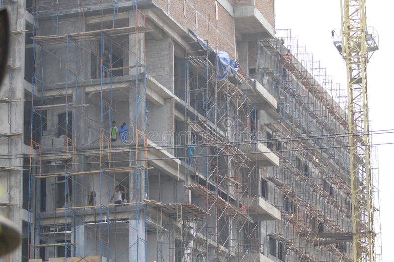 Security systems storey building workers. Workers completed the construction of multi-storey building activity in Solo, Central Java, Indonesia. Still lack stock image