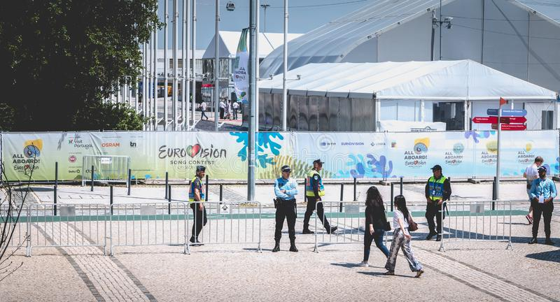 Security team monitoring the entrances to 2018 Eurovision in Lisbon, Portugal. Lisbon, Portugal - May 7, 2018: Security team monitoring the entrances to 2018 stock photos