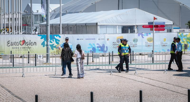 Security team monitoring the entrances to 2018 Eurovision in Lisbon, Portugal. Lisbon, Portugal - May 7, 2018: Security team monitoring the entrances to 2018 royalty free stock photos