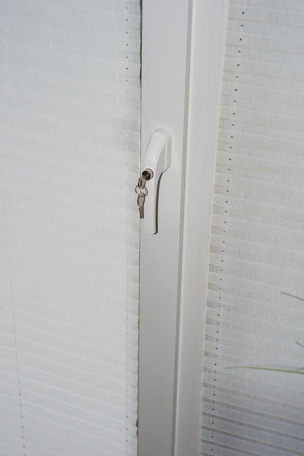 Security technology - lock on door window handle as burglary pro stock photo