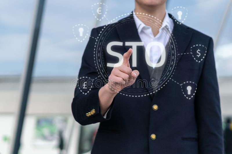 Security Token Offering STO cryptocurrency and blockchain concept, businessman pressing virtual graphics on virtual. Security Token Offering STO cryptocurrency stock images