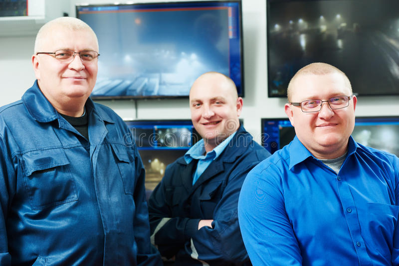 Security video surveillance team. Security executive chief in front of video monitoring surveillance security system team stock photography