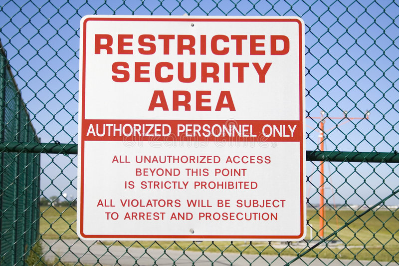 Securty Sign. Never sharpened; restricted security sign posted on fence of Cleveland Hopkins airport royalty free stock photography