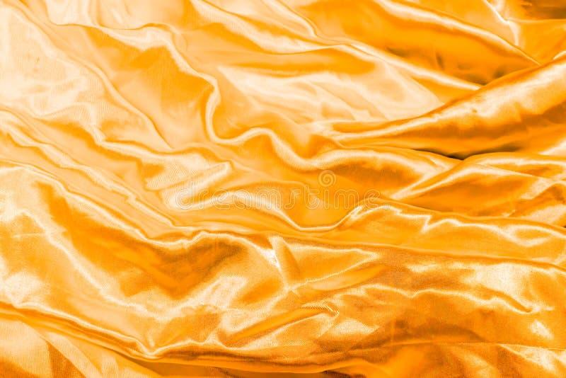 Seda de oro elegante lisa fotografía de archivo libre de regalías