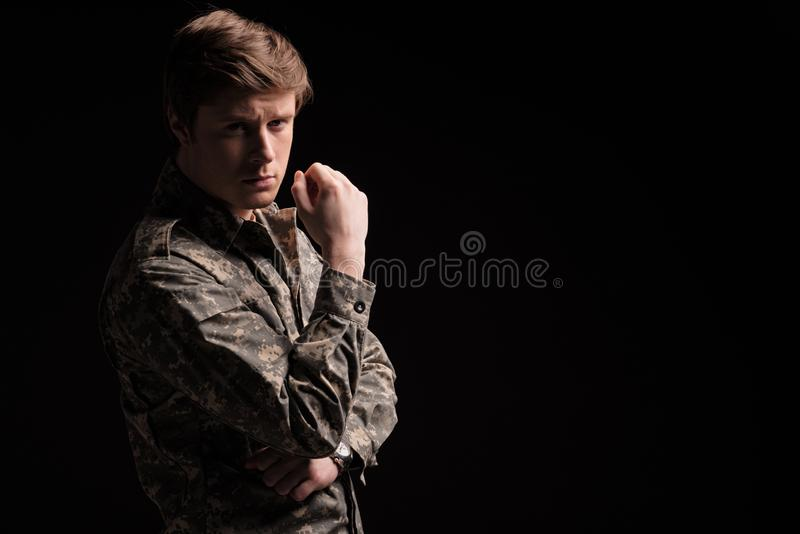 Earnest young soldier thinking about past royalty free stock photos