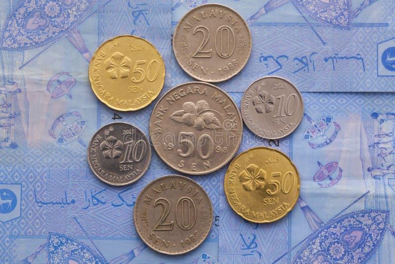 Sedel och mynt av ringgiten av Malaysia arkivbild