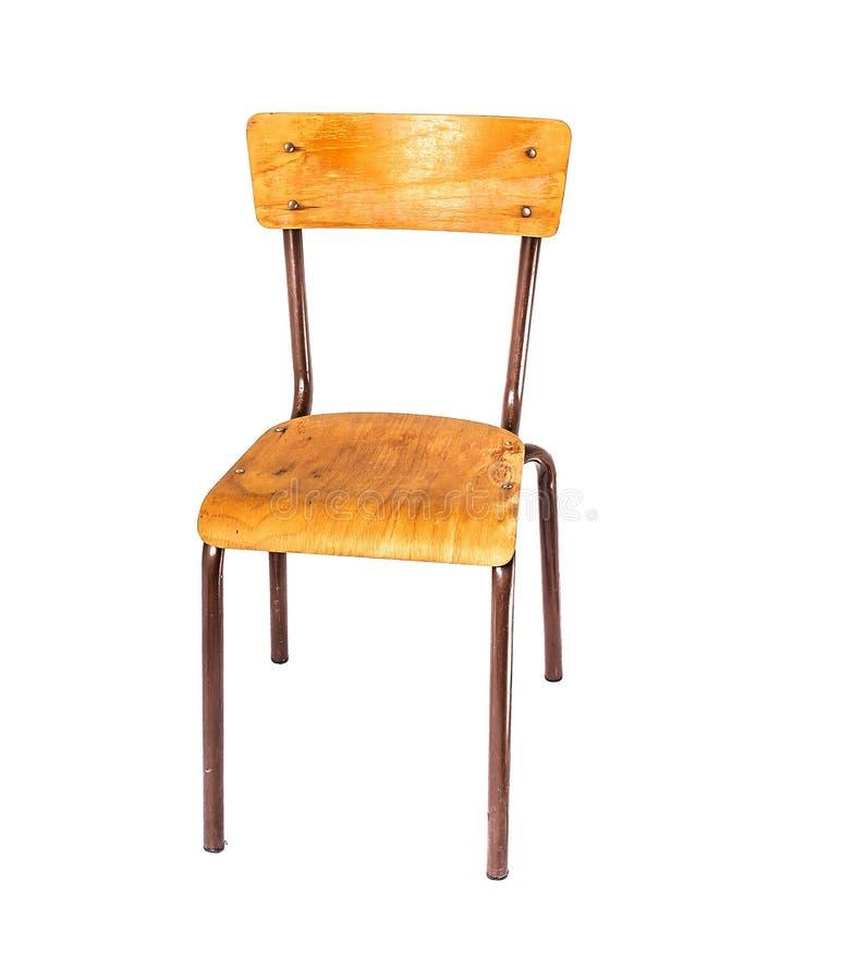 Sedia d'annata dell'ufficio con un sedile di legno sulle gambe del metallo fotografia stock