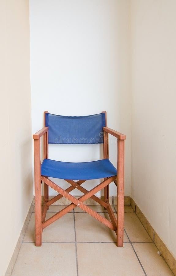 Sedia di direttori di marrone blu fotografia stock libera da diritti
