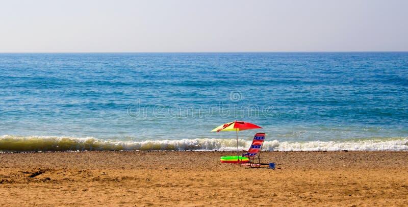 Sedia nella spiaggia immagine stock