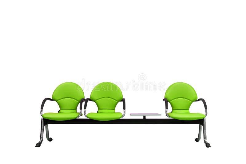 Sedili moderni verdi isolati su bianco fotografie stock