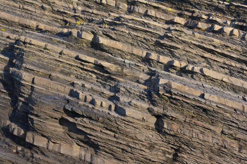 Sedimentary rock layers. A close up of the sedimentary rock layers that make up the Aberystwyth Grits stock images