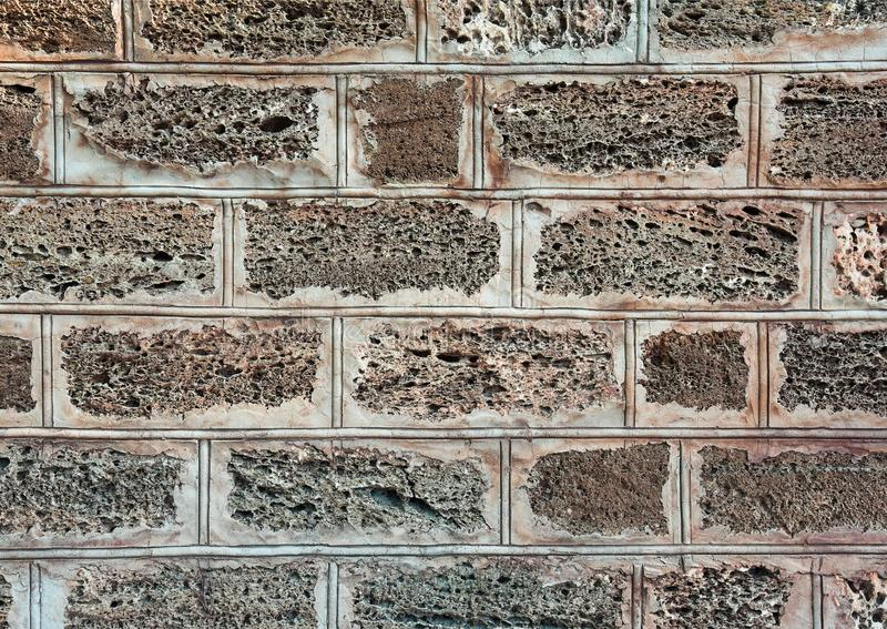 Sedimentary rock wall, fence, exterior, texture. Widely used in coastal places for build wall of house or fence, Ukraine. Sedimentary rock wall, fence, exterior stock image