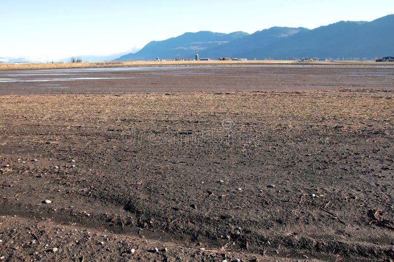 Sedimentos da terra e do rio de exploração agrícola imagem de stock