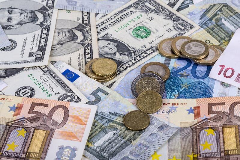 Sedlar och euromynt och dollar royaltyfria foton