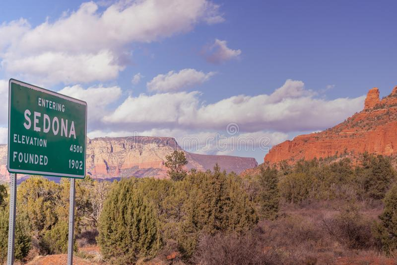 Sedona,Arizona, road sign with red rock mountain landscape royalty free stock image
