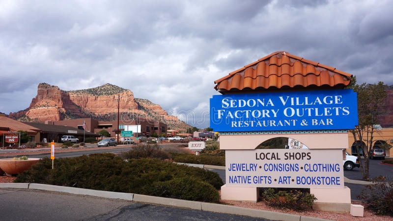 Sedona Village Factory Outlets. SEDONA, ARIZONA - FEBRUARY 04, 2014: Visitors enjoy the local merchants offering everything from local music to Native American royalty free stock photography