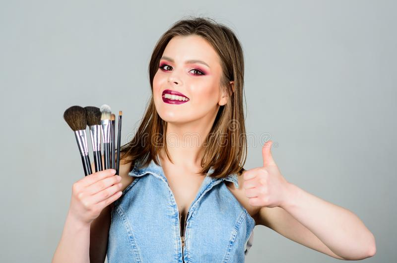 Seducing you. sexy woman with professional make up brush. beauty hairdresser salon. Lipstick and eyeshadow. sexuality. Skincare cosmetics. fashion makeup royalty free stock photos