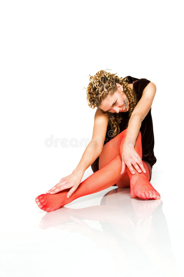 Seducing young girl in red stockings royalty free stock images