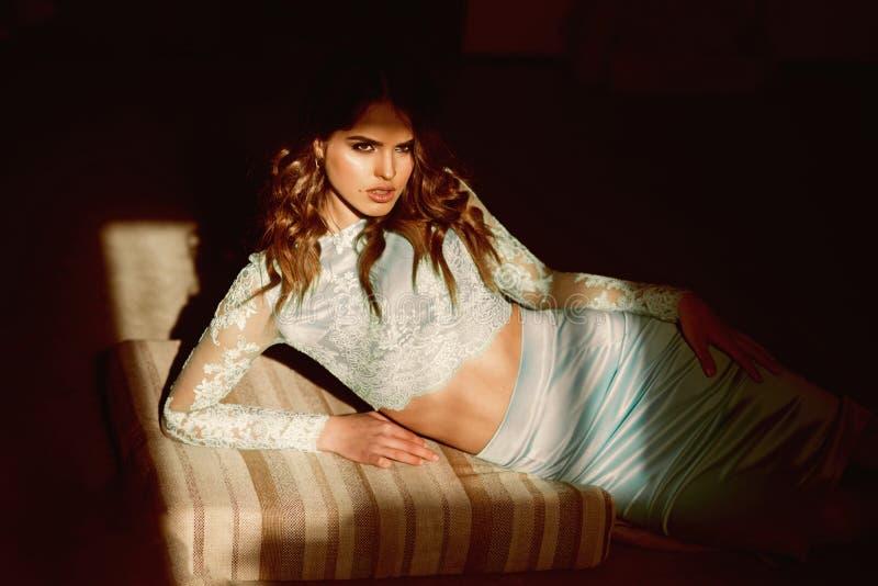 Seduction concept. seduction of elegant woman in sunlight. thoughtful beauty. Seduction concept. seduction of elegant woman in sunlight. thoughtful beauty stock photo