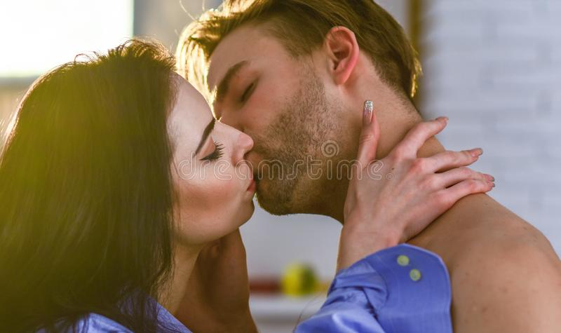 Seduction and foreplay. Celebrate valentines day. Sensual kiss of lovely couple close up. Passionate kiss concept. Couple in love kissing with passion. Man and royalty free stock images