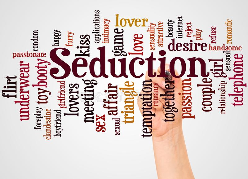 Seduction word cloud and hand with marker concept stock images
