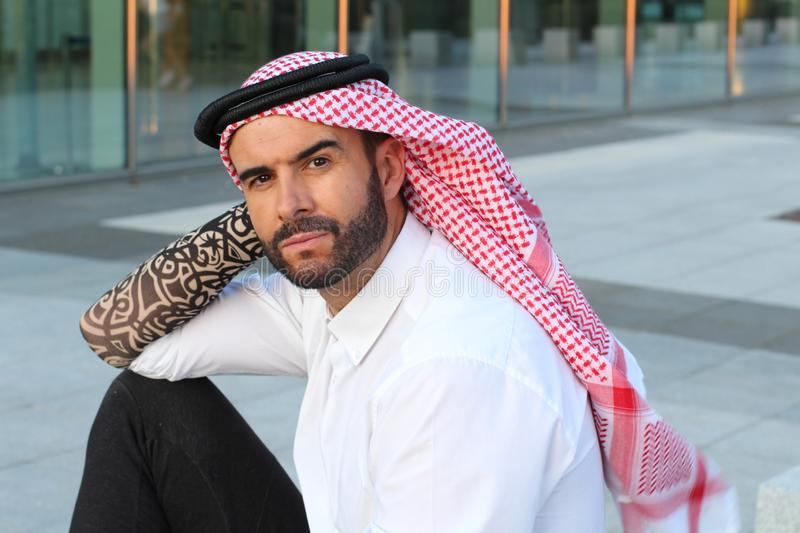 Seductive Arabic man with hipster look royalty free stock photo