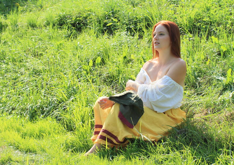 Seductive girl. Young seductive woman - brunette girl in yellow skirt putting down her white blouse stock image